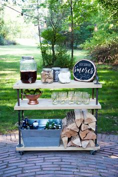 Lumber and pipes were used to make this s'mores fixings cart from Brooklyn Limestone. Positioned on wheels, the BBQ cart works as a firewood caddy or outdoor bar cart as needed.