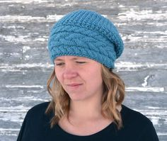 """THIS IS A KNITTING PATTERN for Stillness of Winter Hat! This is an automatic PDF download. You will receive an email with instructions to download this file. Looking for a hat pattern with a wide cable brim? This hat features a wide brim with 3 cable pattern. This hat comes in many sizes: Toddler – 16"""" x 7 ½ """" [40.6 cm x 19.1 cm] 6 – 12 yrs - 18"""" x 9½"""" [45.7 cm x 24.1 cm] Adult Small - 19"""" x 10 ½"""" [48.3 cm x 26.7 cm] Adult Medium - 20"""" x 11"""" [50.8 cm x 29.3 cm] Adult Large - 21"""" x 11 ½""""…"""