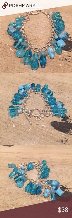 Sterling charm bracelet Sterling silver chain with different shades of blue glass beads attached. Fun and flirty. Sterling toggle. Handmade Jewelry Bracelets