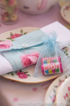 Vintage napkin wrap to hire. Voile favour bag with love heart sweets.  www.fuschiadesigns.co.uk