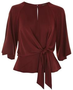 See this and similar Topshop blouses - Be elegant in this burgundy knot front blouse with plunge back detail. Style with jeans or mensy trousers and heels for a. Topshop Tops, Cut Back Shirt, Slouchy Shirt, Slouchy Tops, Knotted Shirt, Blouse Dress, Red Blouses, Holiday Outfits, Blouse Designs
