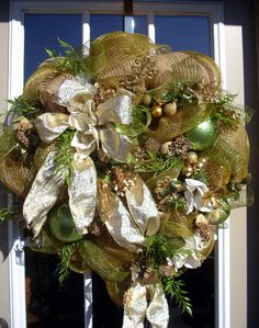 Christmas Wreath in gold and soft greens, with magnolia flowers