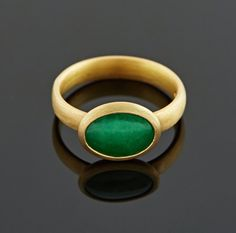 #Jade set in #22ct gold ring.