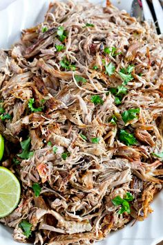 Tender slow cooker carnitas that are so juicy and full of flavor, and crispy with no frying! Stuff them into tacos, burritos or even enchiladas!