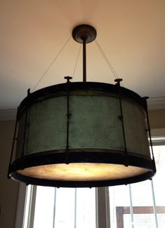 """Light fixture made with a vintage 26"""" bass drum."""