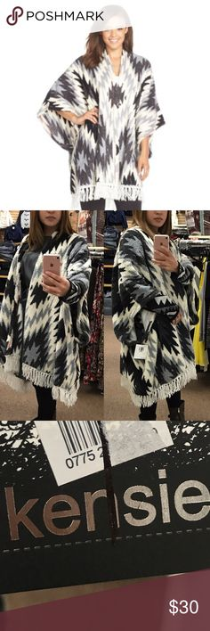 """Kensie Fleece Poncho Robe Details Southwestern patterns perfectly complement the poncho fit of this cozy fleece robe stylish enough to take you straight from lounging to the streets. One size fits most. - Open front - Poncho sleeves - Allover print - Fringe trim - Approx. 38"""" length with 3.5"""" fringe - Imported Fiber Content 100% polyester Care Machine wash cold Kensie Jackets & Coats Capes"""