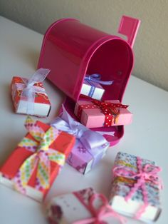 Valentine's Day treat boxes.  Made from covered match boxes.