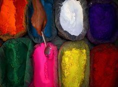 """Katie, one of J Crew's men's designers:  """"A while back, I came across this photo of a Nepalese vendor scooping up colored powder, and to this day, I think the colors are just stunning."""""""