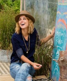 The lovely Kelly Framel wears our petite stone locket to the beach! @theglamourai