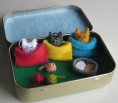My sweet miniature cats measures just 7/8 tall. I carefully stitched them from felt and stuffed them with polyester fiberfill. They have the tiniest of detailing with threads and a cute little embroidery floss tail.  Included for each of these tiny cats is a cozy fleece snuggle bag and 3 tiny balls of yarn. Theres also a food bowl for when they get hungry. The best part is all of these little pieces can be played with and stored in the fabric covered Altoid tin measuring 3 3/4 by 2 1/4 by…