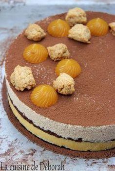 Entremets mandarine pralin. Biscuit citron, crème à la mandarine, biscuit chocolat, mousse légère au praliné et le croquant du streusel!