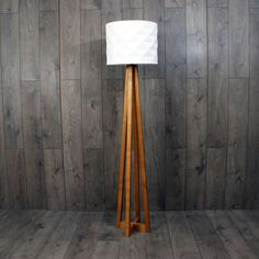 Handmade solid oak floor lamp stand - lampshade not included.Available in natural oak, fumed oak (dark brown) or limed oak (light whightened oak).Each of our beautiful Avenir floor lamps are made in our Nottinghamshire workshop to order. Hand cut, shaped and assembled from sustainably sourced oak. We've hidden the wiring within the leg to keep it looking good from top to bottom, and the brass light fitting is suitable for most regular light shades. It's supplied without the shade so you can…