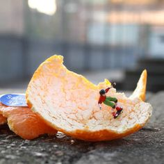 slinkachu-i found this one creative because most people wouldnt even notice a orange peel and would just wak past it but hes took the time to think about how he can make something interesting from it.