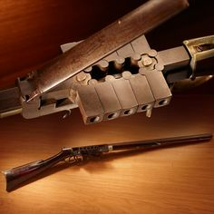 """Bennett & Haviland Many-Chambered Revolving Rifle – It sure feels like a weird gun Wednesday. In 1838 this twelve-shooter .40 caliber wonder was strictly a limited edition. It's been estimated that only ten were made in total over a 2-year production run. Cranking the wheel on the underside rotated the rectangular """"chambers"""" into firing position. On display at the NRA National Firearms Museum in Fairfax, VA."""