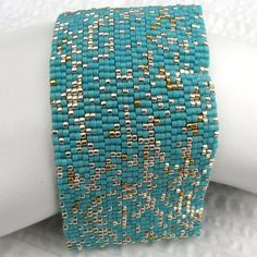 Turquoise with Silver and Gold Peyote Cuff / Peyote Bracelet (2076) - A Sand Fibers Made-to-Order Creation. $59.00, via Etsy.