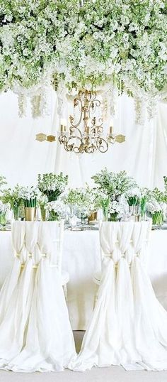Garden-themed wedding. Very high end. But, of note is that there is white with lots of green, and that is also on the tables.