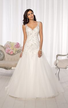 From the Essense of Australia designer wedding dress collection comes this princess-inspired fun and flirty fit and flare wedding gown. Features a super-feminine sweetheart neckline, elegant Diamante beaded cap sleeves, a low V illusion back, and a full skirt and court train of flowing Tulle.