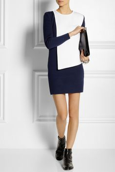 J.W.ANDERSON Paneled wool-blend dress $1,300  British designer J.W.Anderson is renowned for his cool, innovative collections. From the acclaimed Fall '13 lineup is this navy wool-blend dress, featuring a loose, white panel, secured at the shoulder. Balance the high hemline with boyish boots.  Shown here with: Bottega Veneta bracelets, Valentino bracelet, Church's boots, Maison Martin Margiela clutch.