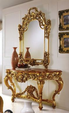 "65""W X 22""D X 35""H Hand carved console with gold leaf finish. Breccia, natural red marble top. CAP-232/S Mirror 39""W X 63""H Hand carved frame."