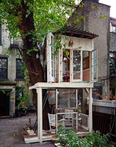 city tree  . . .  fort? patio? addition?