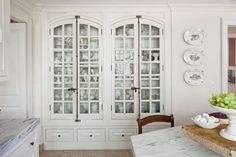 China Treasure Chest Built-ins make beautiful solutions for any space and ensure that there is a place for everything. This dreamy china cabinet features antique French windows as doors, plenty of space for china, and a base outfitted with Pacific Silvercloth for storing silver. | Southern Living