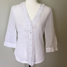 Michael Kors Striped Button Down 8P White blouse with silver stitching and ruffled neckline. MK signature buttons. 3/4 sleeves. Tagged 8P. 99% cotton, 1% metallic. Never worn. Michael Kors Tops Button Down Shirts