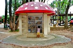 in the center of a beautiful playground in the Kyoto Botanical Gardens, this rain-proof mushroom, whose stem contains large, deep doors exposing a free lending library of books for all ages of kids.