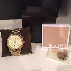 Used MICHAEL KORS WATCH price FIRM JUST LOWERED! Michael KORS watch. Please see all photos. This watch is worn! Scratched on the face near the 12 dial! Needs a battery. Comes with box, extra links and original price tag and booklet!  guaranteed authentic!! Please ask all questions before buying. Some wear to the gold tone! PRICE IS COMPLETELY FIRM! I WILL NOT BE LOWERING THE PRICE AGAIN! Michael Kors Jewelry