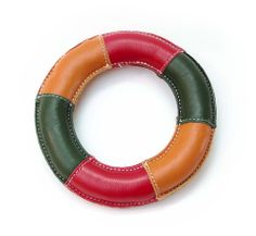 Frisbee Leather Dog Toy Colors Made from soft and durable leather, this toy features the shape of a frisbee. It's perfect for dogs who love to be outside and play catch. It features a subtle squeaker for additional fun. 24.99