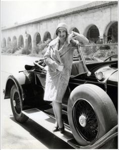 1920s woman in coat with automobile. Love those running boards