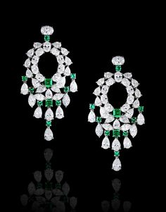 Four emerald and sixteen round-brilliant-cut Emeralds weighing a total of 2.20 carats mounted with pear, marquise and oval-shaped diamonds totaling 19.80 carats, handcrafted in 18 karat white gold. Image 1 of 18