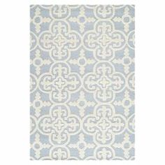"""Anchor your living room seating group or define space in the den with this artfully hand-tufted wool rug, showcasing a quatrefoil tile motif for eye-catching appeal.   Product: RugConstruction Material: WoolColor: Light blue and ivoryFeatures: Hand-tuftedPile Height:0.63"""" Note: Please be aware that actual colors may vary from those shown on your screen. Accent rugs may also not show the entire pattern that the corresponding area rugs have.Cleaning and Care: Professional cleaning recommended"""