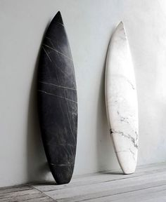 These surfboards show contrast for the stark difference in color between the two, being black and white(One being the absence of color, the other containing them all.)