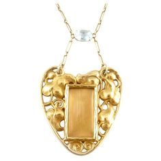 Art Nouveau Aquamarine Gold Pendant Picture Frame Necklace. !8kt Gold necklace pendant, centering a glass picture frame with aquarmarine accent. Engraved on the back with date and inscription.