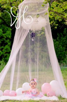 Creative one year old celebration photos including cake smash, grandma's pearls, ball pit, and a canopy.