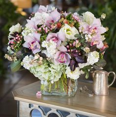 Send Queen for a Day Cymbidium Orchid & Hydrangea Bouquet in Pasadena from Jacob Maarse Florists. Beautiful Queen for a Day Cymbidium Orchid & Hydrangea Bouquet by Pasadena's best florist. Save money with flower delivery directly with a local florist.