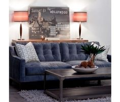 Tufted grey-blue sofa? Yes, please!