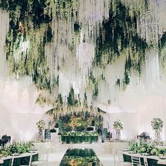 I've never come across a wisteria covered ceiling that we didn't love and this enchanting design, complete with crystal chandeliers, is no exception! WedLuxe Magazine
