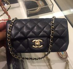Chanel Black Caviar Classic Flap Extra Mini Bag fits more than you can imagine. Love.