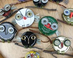 Repurposed owls made from old metal lids, bottle caps, and other scrap pieces