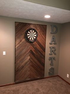 Wooden dart board wall in the man cave or game room. Basement Makeover, Basement Renovations, Home Remodeling, Basement Remodel Diy, Game Room Basement, Basement House, Basement Ideas, Basement Bathroom, Diy Basement Furniture