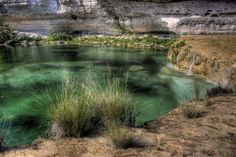 Blue Hole at Riding River Ranch (Leakey). Open to overnight guests only, spending the night at this scenic ranch is totally worth it for a dive in this gorgeous, secluded, and pristine swimming hole surrounded by canyons.