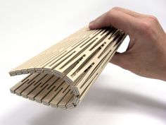 dukta sonar  - flexible wood and wood materials. Through the cuts, the material receives nearly textile properties