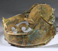 Greek Bronze Tiara, 4th-3rd Century BC The front is decorated in an engraved herringbone pattern and palmettes with perforated ripples along the sides.