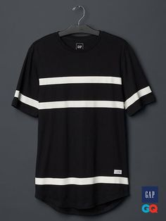 Gap + GQ STAMPD long striped t-shirt - Forget color and logos. Instead, mix athletic gear with streetwear—and focus on how it all fits. That's the formula for Stampd, Chris Stamp's mashup of West Coast surf culture with East Coast street attitude. The result is a line of futuristic sportswear with a gloriously simple color palette (black, white, repeat).