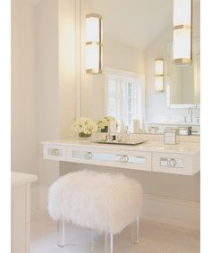 Make sure your vanity is just as stylish as you with these Pinterest-inspired tables that help balance chic modernity and functionality. Pictured: Use a chic accent stool, like this one with a lucite base, to pair with a modern table.