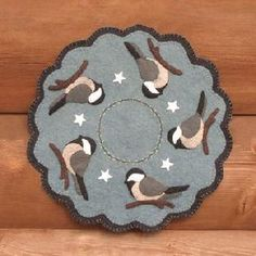 """My Little ChickadeesThis pattern has two options, a wool version that measures 11"""" in diameter, and a wool felt version (with the stars) that measures 12"""" in diameter."""