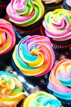 You need to top a dozen cupcakes with Rainbow Swirl Buttercream Frosting.