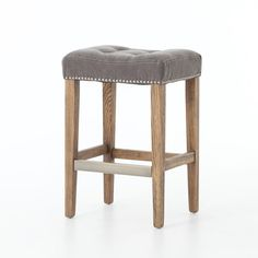 "MSRP $275 Contractor Price $135  Counter stool  Distressed and whitewashed legs are topped with grey, 100% cotton canvas seating. Antique brass kickplate and nailhead trim.  Dimensions: W: 17.75"" D: 15"" H: 26"""