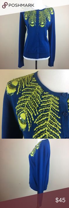 "Tabitha ""Limabird"" Cardigan Embroidered Sweater Anthropologie Tabitha ""Limabird"" Sweater Size: L Color: Peacock Blue, Yellow Embroidery Style: Cardigan Buttons, Beaded, Sequins Material: 100% Cotton Condition: EUC, excellent used condition Measurements laying flat: Length 23.5"", Shoulder seam to seam 16.5"", Bust 20"", Waist 18.5"", Hips 19.5""  E-009 Anthropologie Sweaters Cardigans"